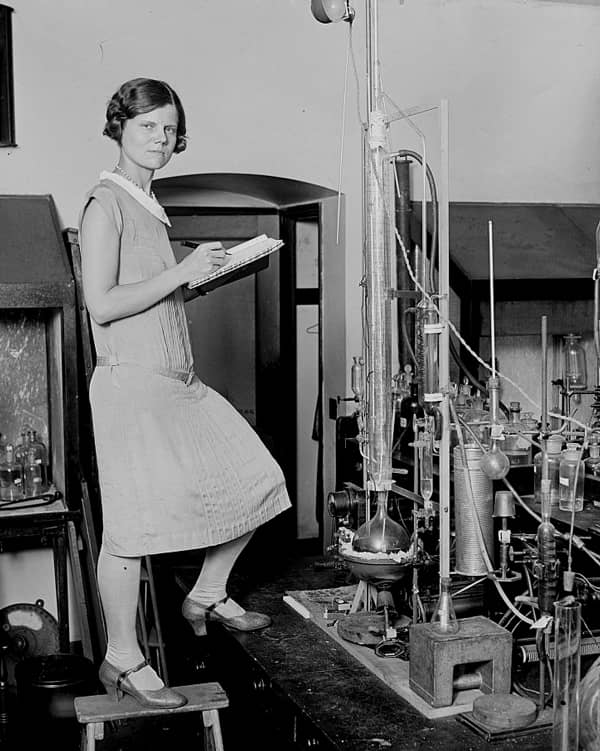 Female scientist in front of vials