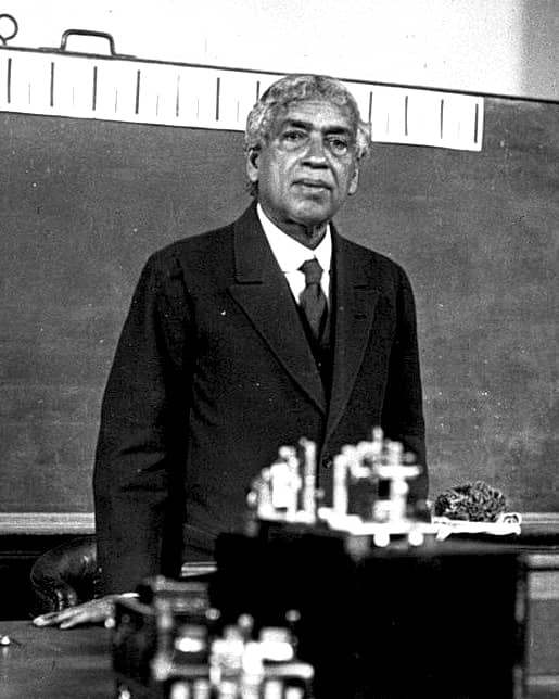 Scientist giving seminar in front of electronics