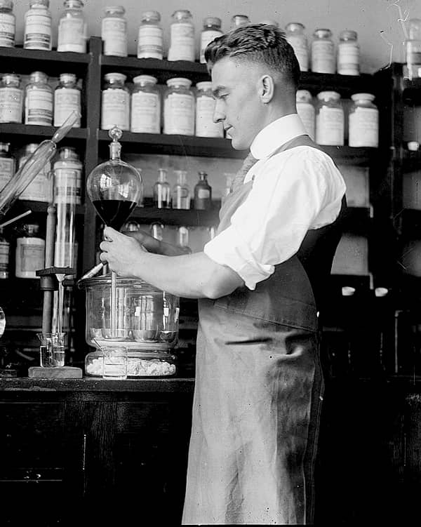 Scientist handling vials