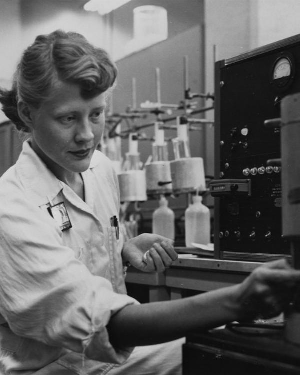lady scientist turning a knob